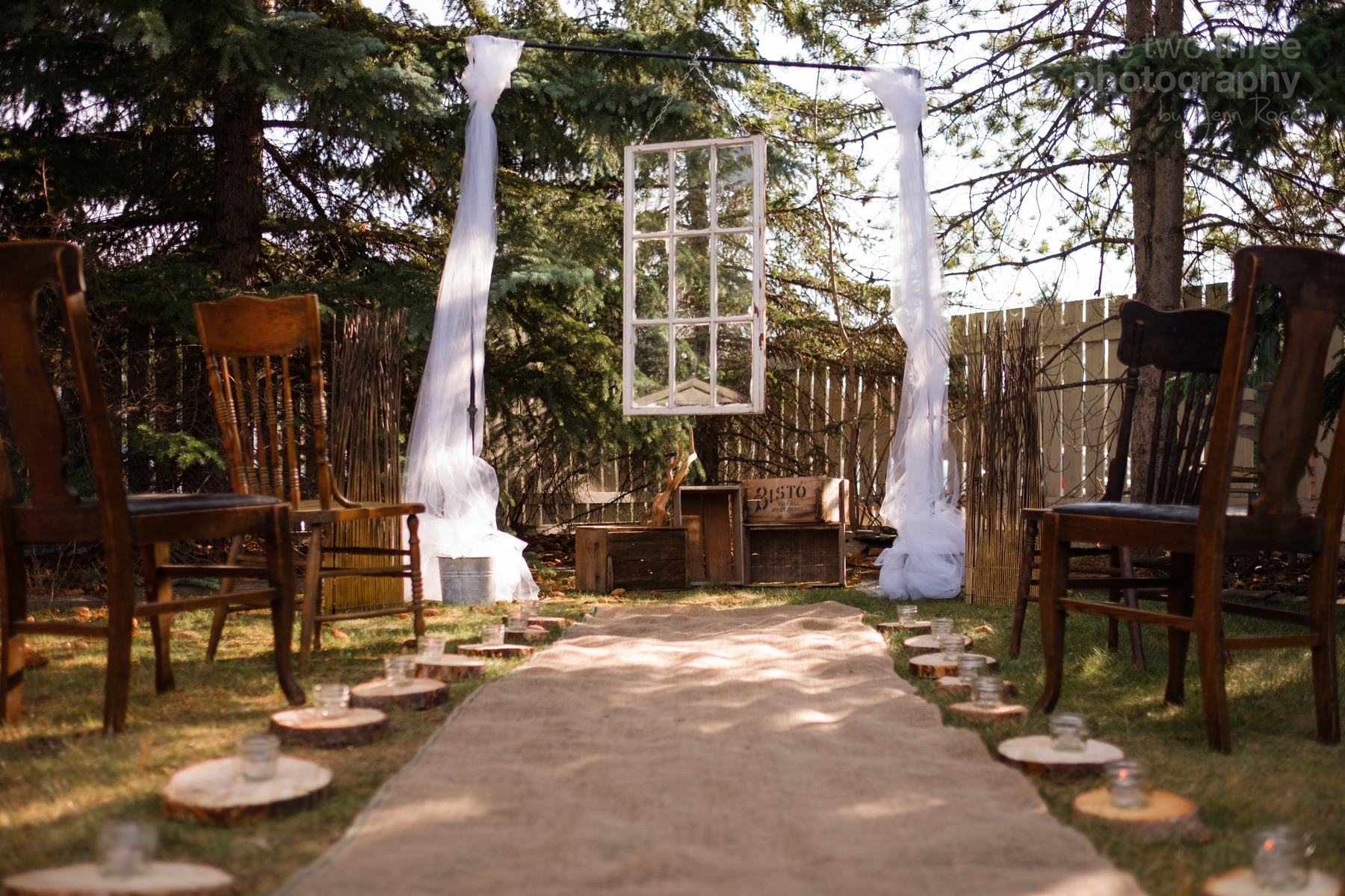 Rustic wedding ideas including vintage windows wood glass jars antique chairs tule and wooden crates
