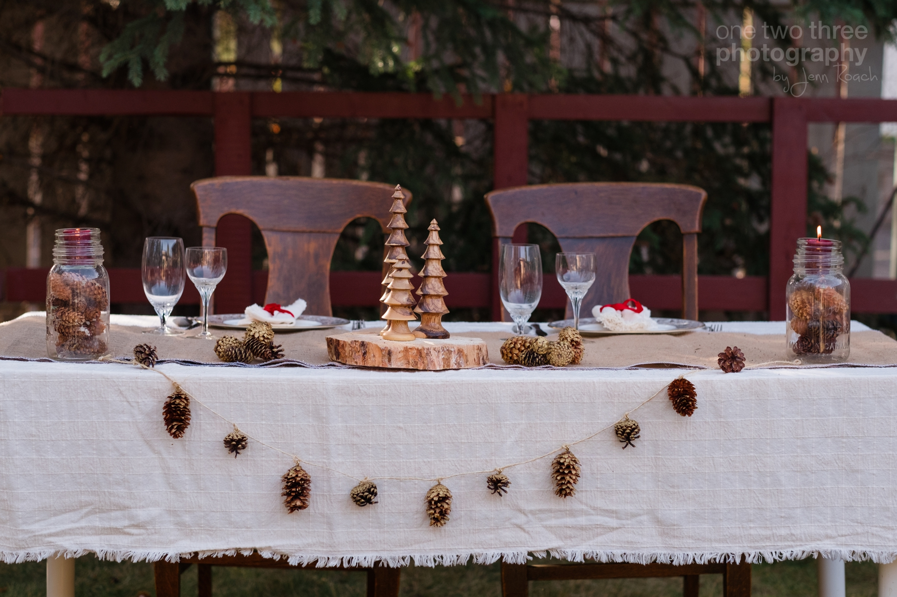 Rustic wedding table settings with pinecones and wood